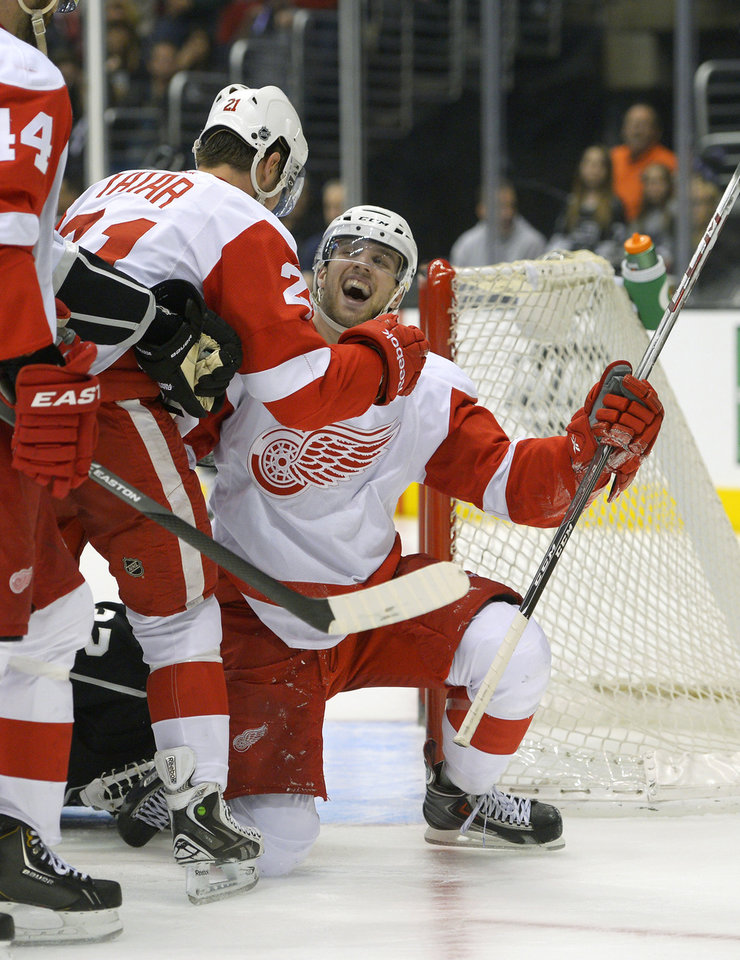 Photo - Detroit Red Wings center Riley Sheahan, right, celebrates his goal with left wing Tomas Tatar, of Slovenia, during the first period of an NHL hockey game against the Los Angeles Kings, Saturday, Jan. 11, 2014, in Los Angeles. (AP Photo/Mark J. Terrill)