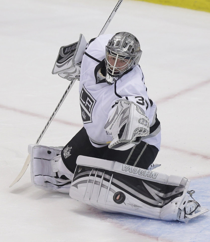 Photo - Los Angeles Kings goalie Jonathan Quick (32) deflects a shot during the second period of an NHL hockey game against the Detroit Red Wings in Detroit, Wednesday, April 24, 2013. (AP Photo/Carlos Osorio)