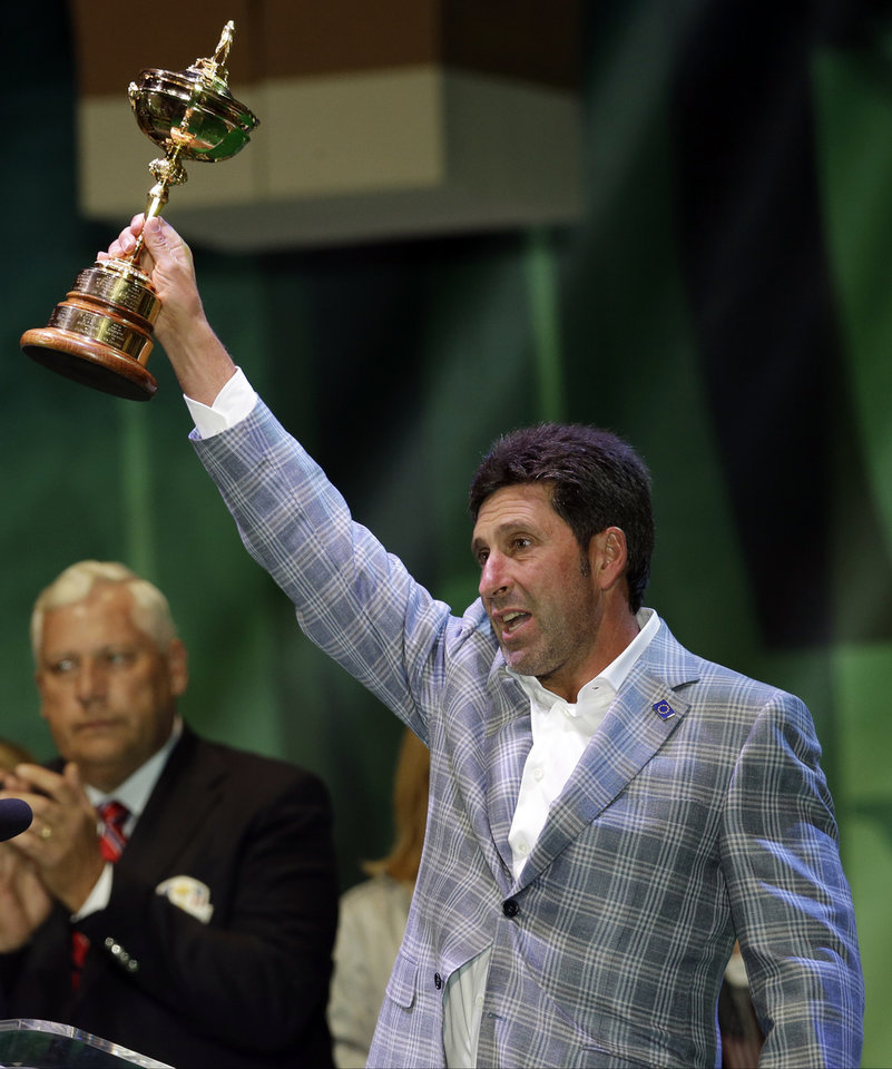 Photo - European team captain Jose Maria Olazabal holds up the trophy at the closing ceremony of the Ryder Cup PGA golf tournament Sunday, Sept. 30, 2012, at the Medinah Country Club in Medinah, Ill. (AP Photo/David J. Phillip)  ORG XMIT: PGA249