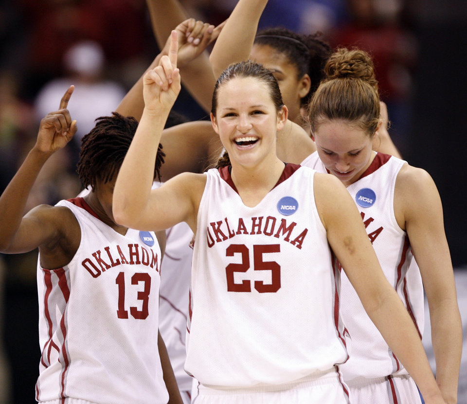 Photo - Whitney Hand and the Sooners celebrate their 70-59 win in the NCAA women's basketball tournament game between the University of Oklahoma and Pittsburgh at the Ford Center in Oklahoma City, Okla. on Sunday, March 29, 2009. 