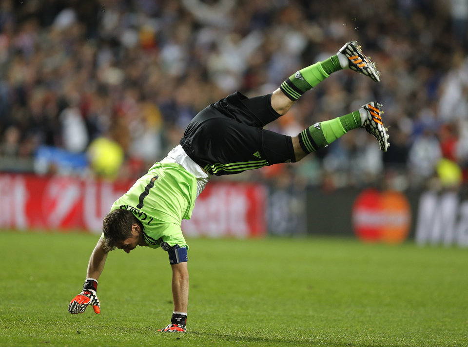 Photo - Real goalkeeper Iker Casillas celebrates after Real's Marcelo scores his side's 3rd goal, during the Champions League final soccer match between Atletico de Madrid and Real Madrid in Lisbon, Portugal, Saturday, May 24, 2014. (AP Photo/Daniel Ochoa de Olza)