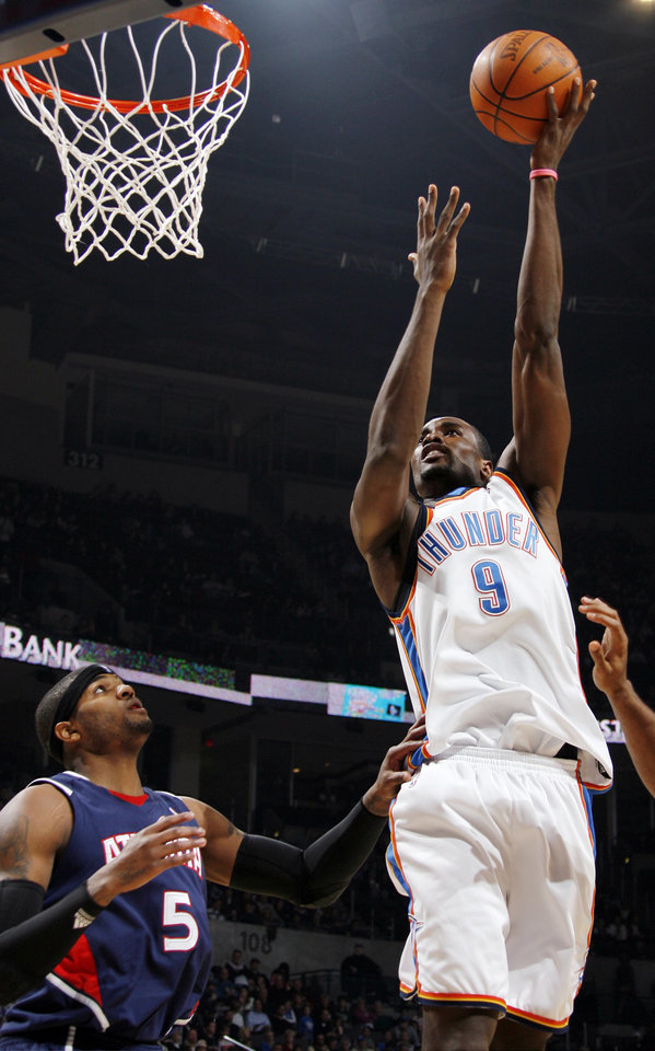 Oklahoma City's Serge Ibaka (9) shoots over Josh Smith (5) of Atlanta during the NBA basketball game between the Atlanta Hawks and the Oklahoma City Thunder at the Ford Center in Oklahoma City, Tuesday, February 2, 2010. Photo by Nate Billings, The Oklahoman