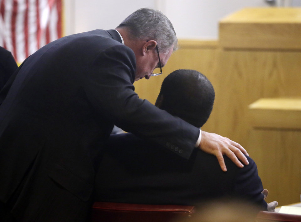 Photo - Defense attorney George Milner, left, leans over and talks with his client, former Dallas Cowboy NFL football player Josh Brent during Brent's trial for intoxication manslaughter, Friday, Jan. 17, 2014, in Dallas. Brent is accused of driving drunk at the time of a December 2012 crash that killed Cowboys practice squad player Jerry Brown. (AP Photo/Tony Gutierrez)