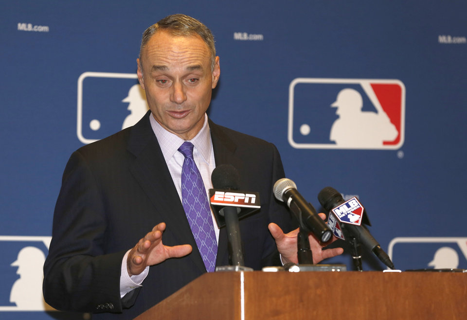 Photo - Rob Manfred, Chief Operating Officer of Major League Baseball, talks to the media following baseball's general managers' meetings Thursday, Nov. 14, 2013, in Orlando, Fla. (AP Photo/Reinhold Matay)