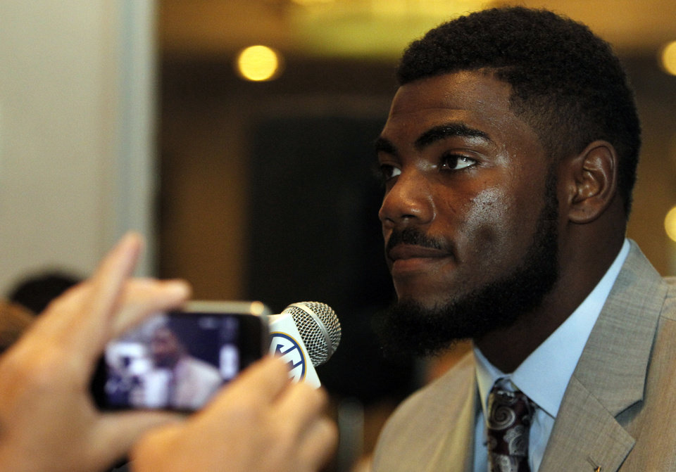 Photo - Alabama safety Landon Collins speaks to the media at the Southeastern Conference NCAA college football media days Thursday, July 17, 2014, in Hoover, Ala. (AP Photo/Butch Dill)