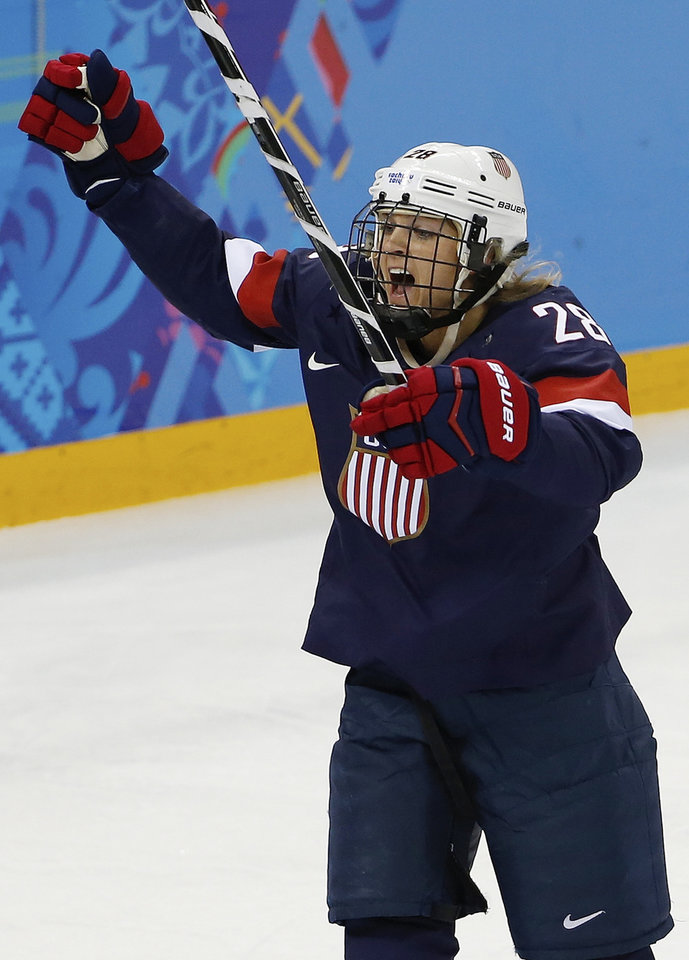 Photo - Amanda Kessel of the Untied States celebrates her goal against Switzerland during the first period of the 2014 Winter Olympics women's ice hockey game at Shayba Arena, Monday, Feb. 10, 2014, in Sochi, Russia. (AP Photo/Petr David Josek)