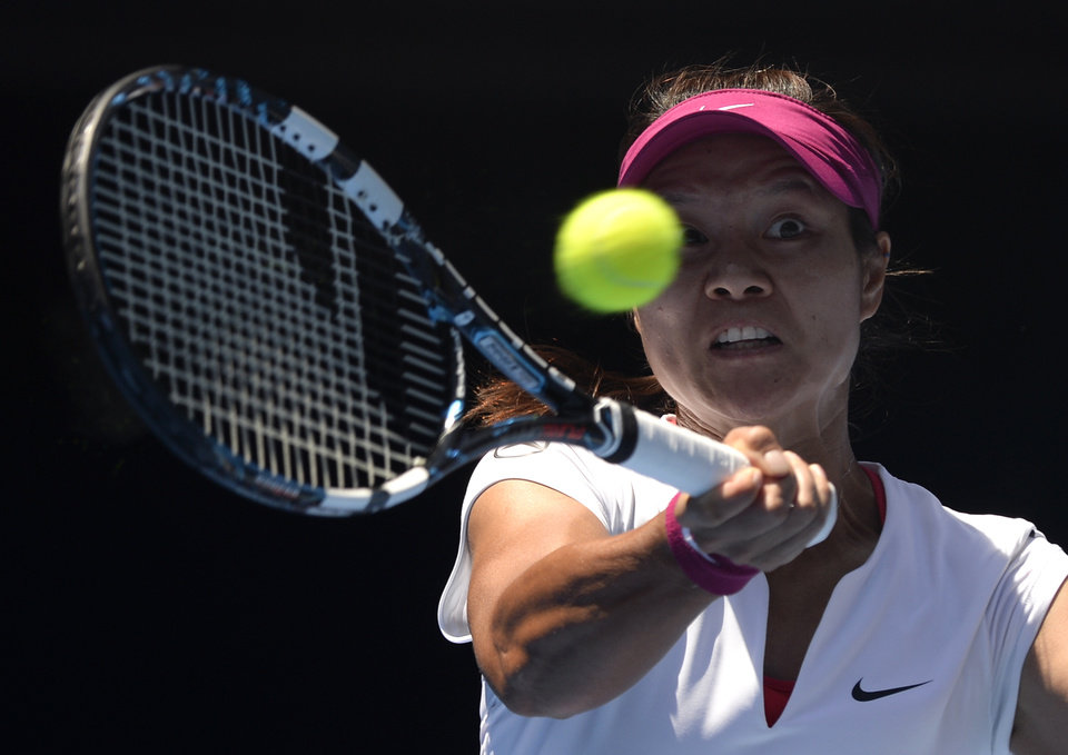 Photo - Li Na of China  makes a forehand return to Eugenie Bouchard of Canada during their semifinal at the Australian Open tennis championship in Melbourne, Australia, Thursday, Jan. 23, 2014.(AP Photo/Andrew Brownbill)