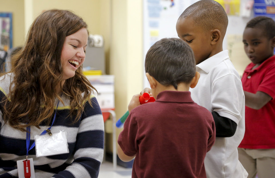 Photo - Teacher Jessica Wilson works with students in her pre-kindergarten class at Putnam Heights Elementary School. Wilson said the Urban Teacher Preparation Academy gave her the tools she needed to teach in an urban school. PHOTO BY CHRIS LANDSBERGER, THE OKLAHOMAN  CHRIS LANDSBERGER - CHRIS LANDSBERGER