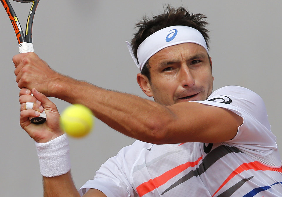 Photo - Australia's Marinko Matosevic backhands to Britain's Andy Murray during their second round match of  the French Open tennis tournament at the Roland Garros stadium, in Paris, France, Thursday, May 29, 2014. (AP Photo/Michel Spingler)