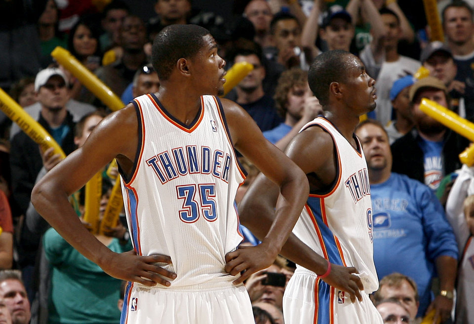 Photo - Oklahoma City's Kevin Durant (35) and Serge Ibaka (9) react during the Thunder's loss to Bston on Sunday. PHOTO BY SARAH PHIPPS, THE OKLAHOMAN