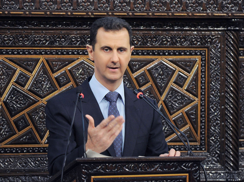 Photo - FILE - In this  June 3, 2012 file photo released by the Syrian official news agency SANA, Syrian President Bashar Assad delivers a speech at the parliament in Damascus, Syria. Israel launched an airstrike into Syria, apparently targeting a suspected weapons site, U.S. officials said Friday night, May 3, 2013. (AP Photo/SANA, File)