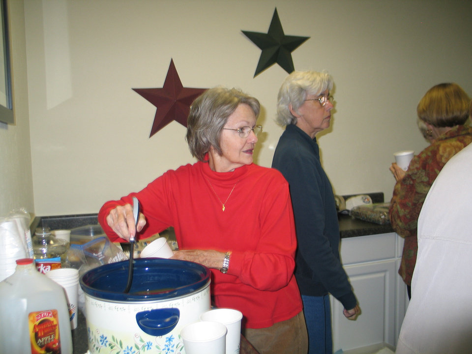 Nita Maxey serves hot cider at the Harrah Historical Society�s Centennial Celebration, November 15<br/><b>Community Photo By:</b> Karen Erbin, editor<br/><b>Submitted By:</b> Karen, Harrah