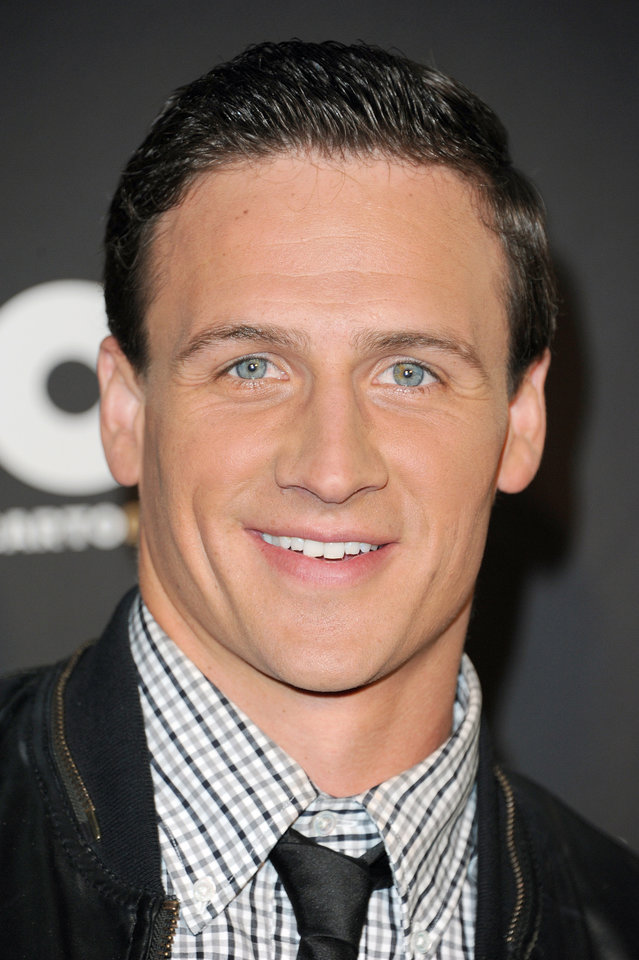 """Photo -  Ryan Lochte arrives at The 3rd Annual Cartoon Network's """"Hall of Game"""" Awards at The Barker Hangar on Saturday, Feb. 9, 2013 in Los Angeles. (Photo by Richard Shotwell/Invision/AP)"""