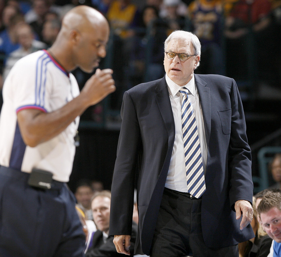 Photo - L.A. LAKERS: Lakers coach Phil Jackson reacts to a call during the NBA basketball game between the Los Angeles Lakers and the Oklahoma City Thunder at the Ford Center, Tuesday, Feb. 24, 2009. The Thunder lost 107-93. PHOTO BY BRYAN TERRY, THE OKLAHOMAN ORG XMIT: KOD