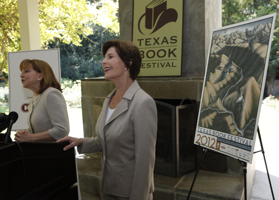 Photo -   Former first lady Laura Bush, right, smiles as Lidia Agraz introduces her at the announcement of the lineup for the 2012 Texas Book festival Wednesday, Sept. 12, 2012, at Bush's home in the Preston Hollow section of Dallas. Bush, who founded the festival when she was first lady of Texas, also unveiled this year's book festival poster for the annual event in Austin. (AP Photo/LM Otero)