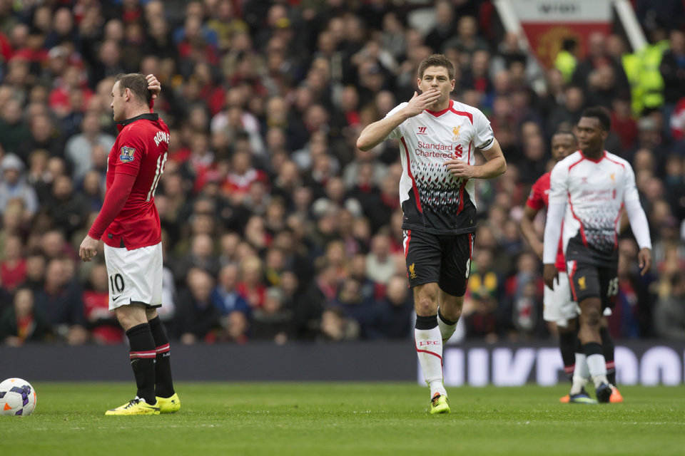 Photo - Liverpool's Steven Gerrard, centre right, celebrates after scoring against Manchester United during their English Premier League soccer match at Old Trafford Stadium, Manchester, England, Sunday March 16, 2014. (AP Photo/Jon Super)
