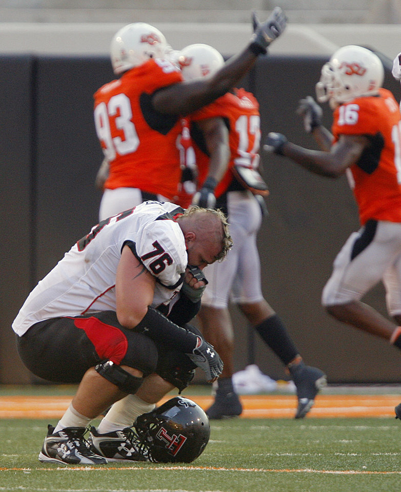 Photo - Texas Tech's Brandon Carter (76) reacts after the Red Raiders did not convert on a fourth down late in the fourth quarter during the college football game between the Oklahoma State University Cowboys (OSU) and the Texas Tech University Red Raiders (TTU) at Boone Pickens Stadium  on Saturday, Sept. 22, 2007, in Stillwater, Okla. 