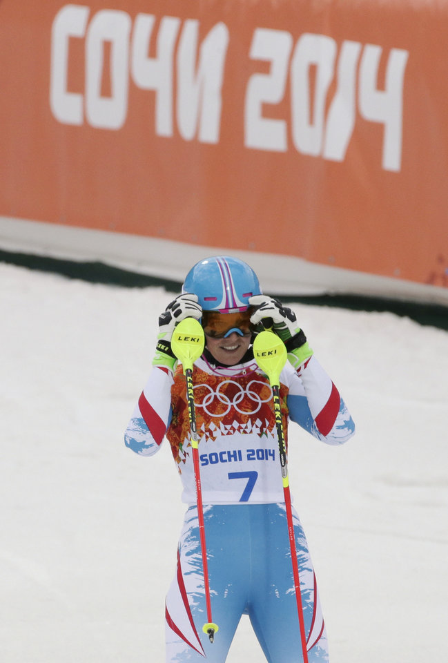 Photo - Austria's Marlies Schild reacts after completing the first run of the women's slalom at the Sochi 2014 Winter Olympics, Friday, Feb. 21, 2014, in Krasnaya Polyana, Russia.(AP Photo/Gero Breloer)
