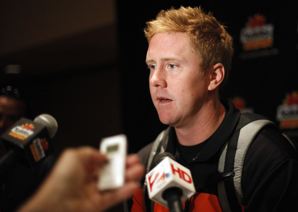 Photo - Oklahoma State's Brandon Weeden talks to the media during an Oklahoma State press conference for the Fiesta Bowl at the Camelback Inn in Paradise Valley, Ariz.,  Thursday, Dec. 29, 2011. Photo by Sarah Phipps, The Oklahoman