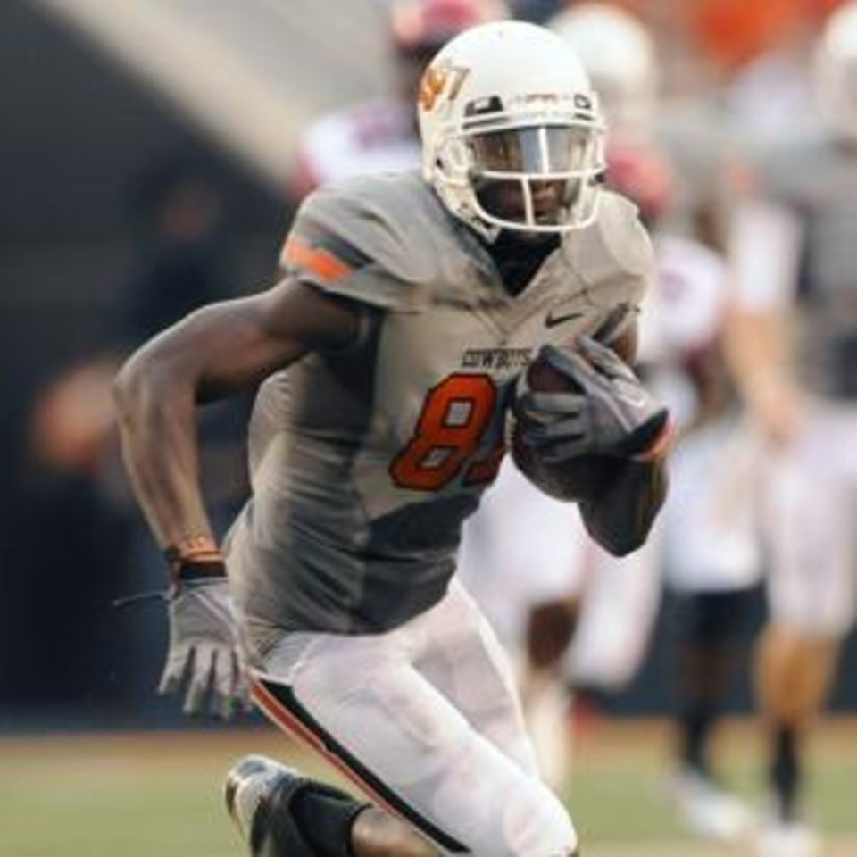 Photo -  Justin Blackmon and the Cowboys are charging ahead.