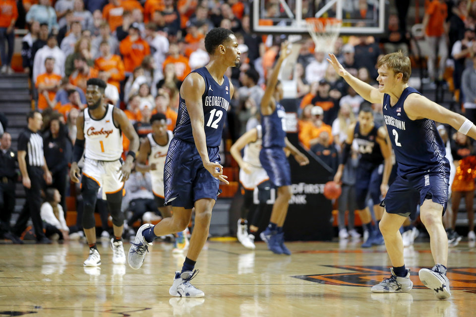 Photo - Georgetown's Terrell Allen (12) and Mac McClung (2) celebrate after a Allen made a basket during a college basketball game between the Oklahoma State University Cowboys (OSU) and the Georgetown Hoyas at Gallagher-Iba Arena in Stillwater, Okla., Wednesday, Dec. 4, 2019. Georgetown won 84-71. [Bryan Terry/The Oklahoman]