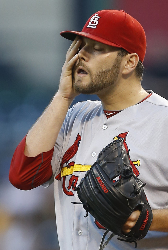 Photo - St. Louis Cardinals starting pitcher Lance Lynn wipes his face after Pittsburgh Pirates' Russell Martin hit a double in the second inning of the baseball game on Tuesday, Aug. 26, 2014, in Pittsburgh. (AP Photo/Keith Srakocic)
