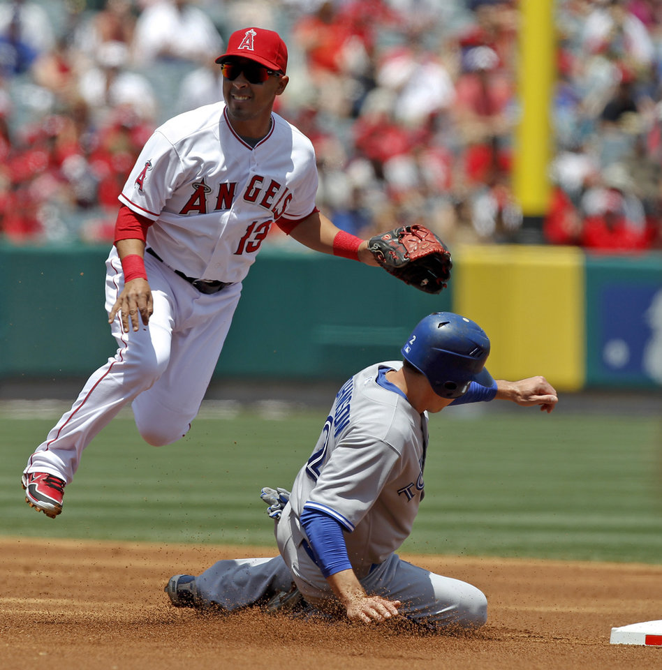Photo -   Toronto Blue Jays' Kelly Johnson, right, is forced out at second by Los Angeles Angels third baseman Maicer Izturis after Jose Bautista hit into a double play during the first inning of a baseball game in Anaheim, Calif., Sunday, May 6, 2012. (AP Photo/Chris Carlson)