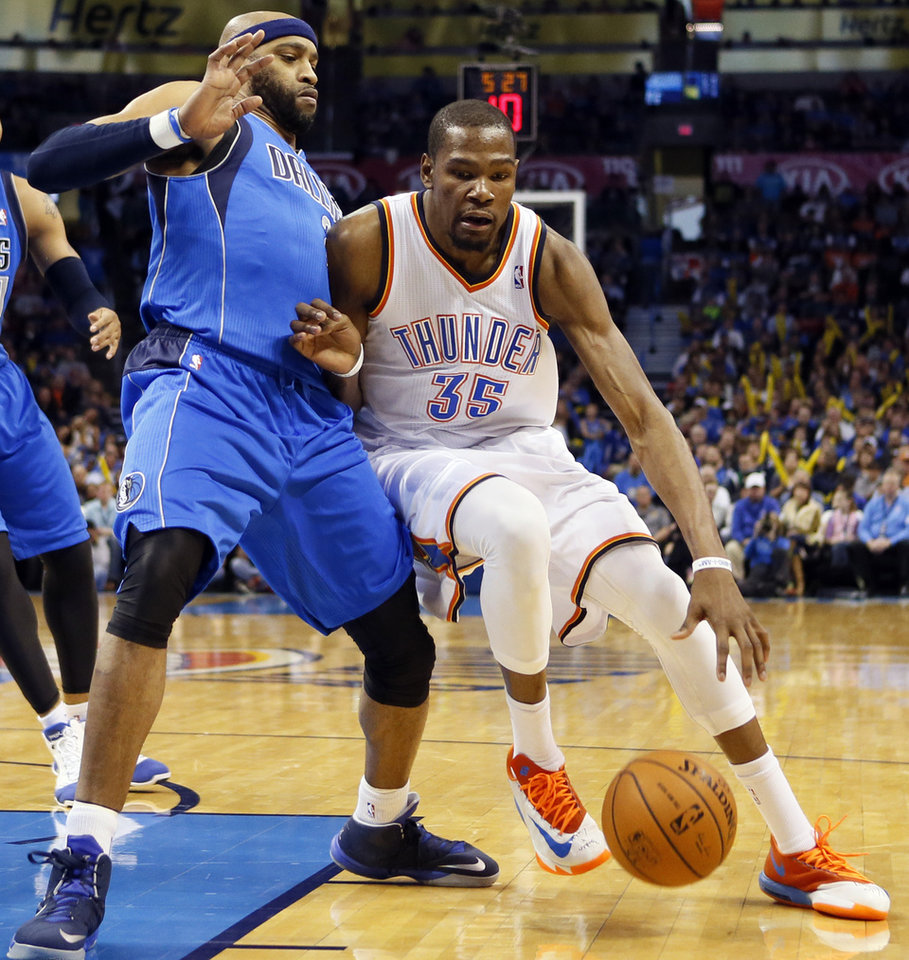 Photo - Oklahoma City's Kevin Durant (35) drives against Dallas' Vince Carter (25) during an NBA basketball game between the Oklahoma City Thunder and the Dallas Mavericks at Chesapeake Energy Arena in Oklahoma City, Sunday, March 16, 2014. Photo by Nate Billings, The Oklahoman