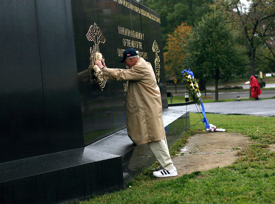 "Clarence ""Bud"" Stark, of Norman, presses his hands against the Marine Corps War Memorial in Arlington, Va., on Wednesday, Oct. 12, 2011. Stark, a Marine during WWII, was on Iwo Jima when the flag was raised. Stark and other veterans from WWII visited memorials in Washington D.C. and Virginia during an Oklahoma Honor Flight on Wednesday. Photo by John Clanton, The Oklahoman"