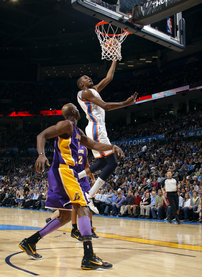 Photo - Oklahoma City's Kevin Durant (35) shoots as Lakers' Lamar Odom (7) looks on during the NBA basketball game between the Oklahoma City Thunder and the Los Angeles Lakers, Sunday, Feb. 27, 2011, at the Oklahoma City Arena.Photo by Sarah Phipps, The Oklahoman