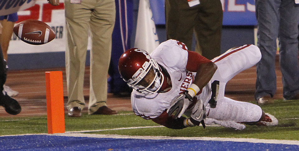 Photo - Oklahoma's Ryan Broyles (85) fumbles the ball out of the back of the end zone for a touchback during the college football game between the University of Oklahoma Sooners (OU) and the University of Kansas Jayhawks (KU) on Sunday, Oct. 16, 2011. in Lawrence, Kan. Photo by Chris Landsberger, The Oklahoman