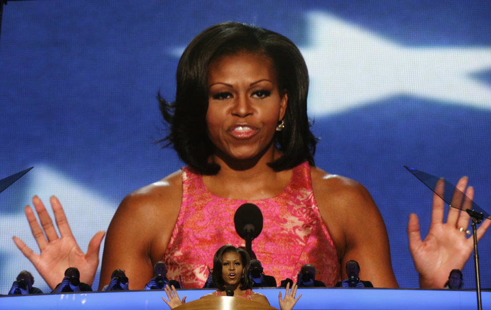 Photo - First Lady Michelle Obama waves to delegates at the Democratic National Convention in Charlotte, N.C., on Monday, Sept. 3, 2012.  (AP Photo/Charles Dharapak)  ORG XMIT: DNC807