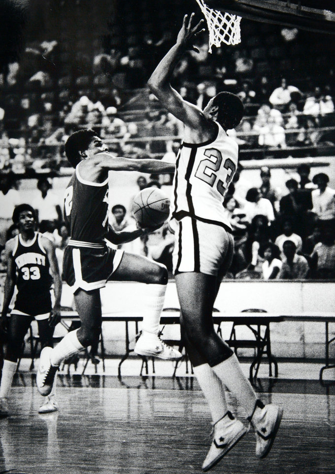 Photo - Former OU basketball player Wayman Tisdale. Tulsa's Wayman Tisdale 23 appears set to block N.W. Kevin Forbes (12). Staff photo by Jim Argo. Photo taken 3/12/1981, photo published 3/13/1981 in The Daily Oklahoman. ORG XMIT: KOD