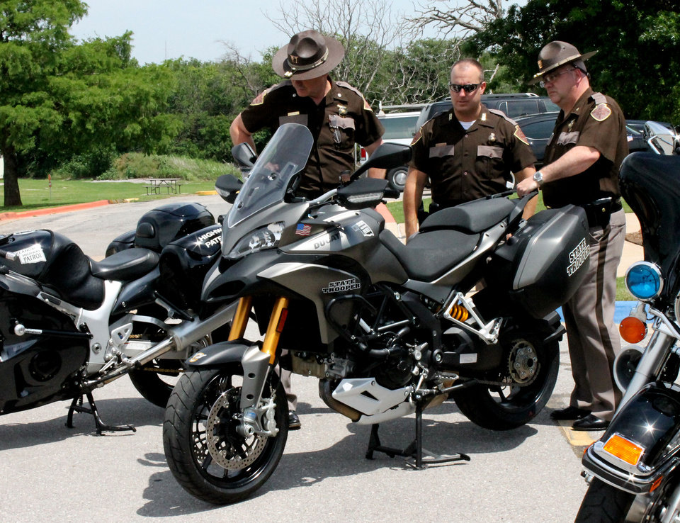 Photo - Troopers look at new motorcycles for a safety and educational program  Thursday at the Oklahoma Department of Transportation Training Center.  Photo by Tiffany Gibson, the oklahoman