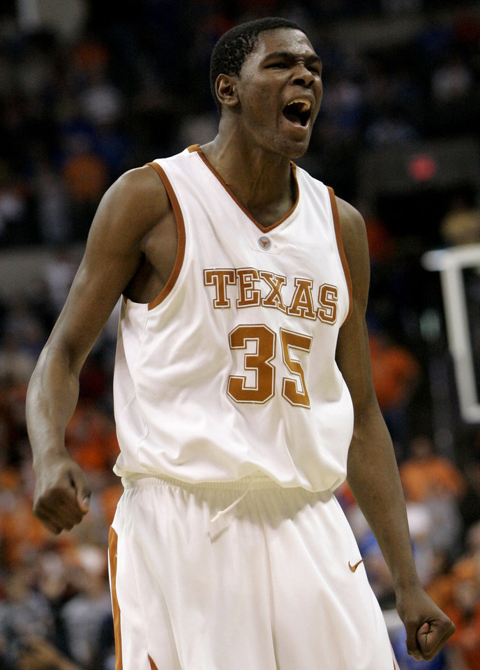 Photo - COLLEGE BASKETBALL / REACTION / OSU: University of Texas guard Kevin Durant (35) reacts near the end of their semifinal basketball game against Oklahoma State University at the Big 12 Conference Tournament in Oklahoma City, Saturday, March 10, 2007. Durant scored 26 points in Texas' 69-64 win. (AP Photo/Sue Ogrocki) ORG XMIT: KOF127