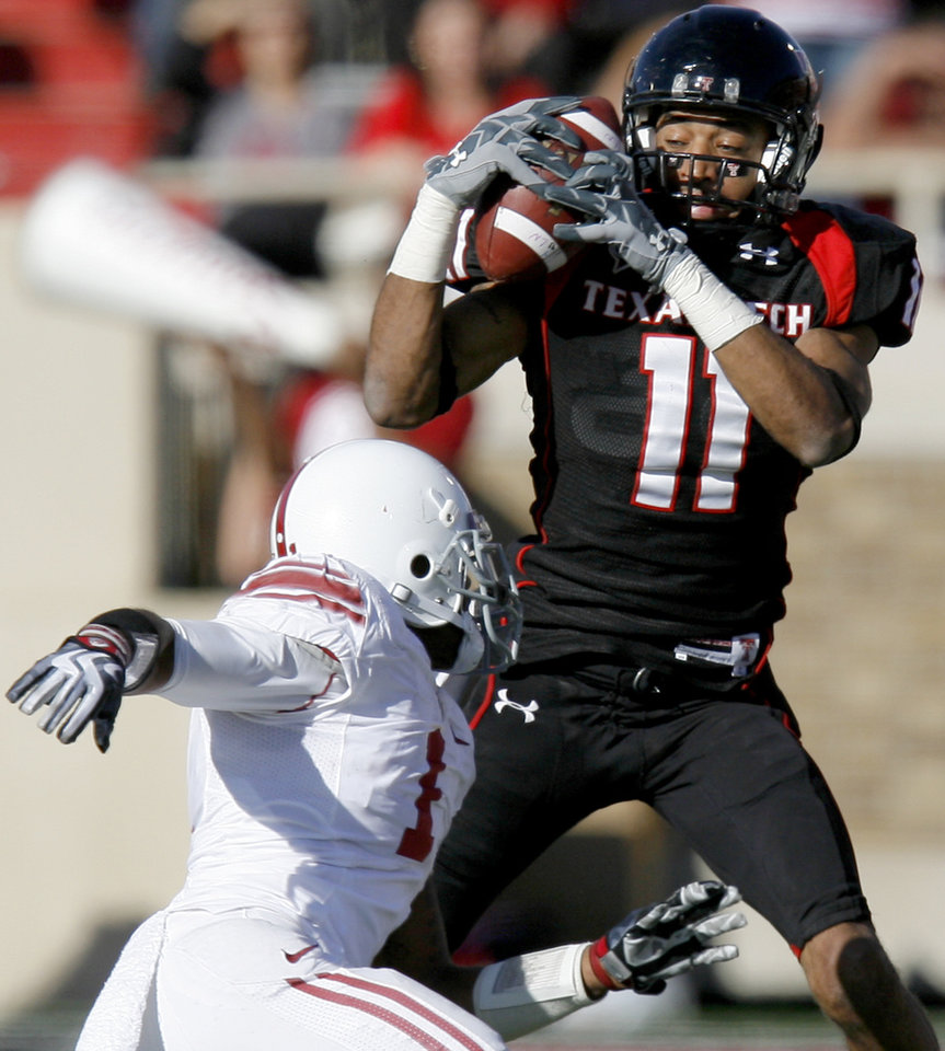 Texas Tech's Tramain Swindall catches a pass over OU's Dominique Franks during the college football game between the University of Oklahoma Sooners (OU) and Texas Tech University Red Raiders (TTU ) at Jones AT&T Stadium in Lubbock Okla., Saturday, Nov. 21, 2009. Photo by Bryan Terry, The Oklahoman