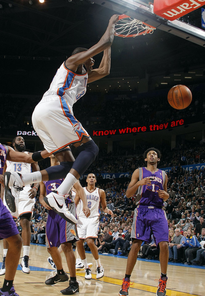 Photo - Oklahoma City's Kevin Durant reacts after a dunk during the NBA basketball game between the Oklahoma City Thunder and the Phoenix Suns, Sunday, Dec. 19, 2010, at the Oklahoma City Arena. Photo by Sarah Phipps, The Oklahoman