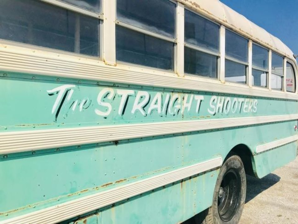 Photo -  One of several buses used to transport young people participating in the Straight Shooters youth ministry is shown at Oklahoma City First Church of the Nazarene where it will be used for similar ministry now that it has been refurbished. [Carla Hinton/The Oklahoman]