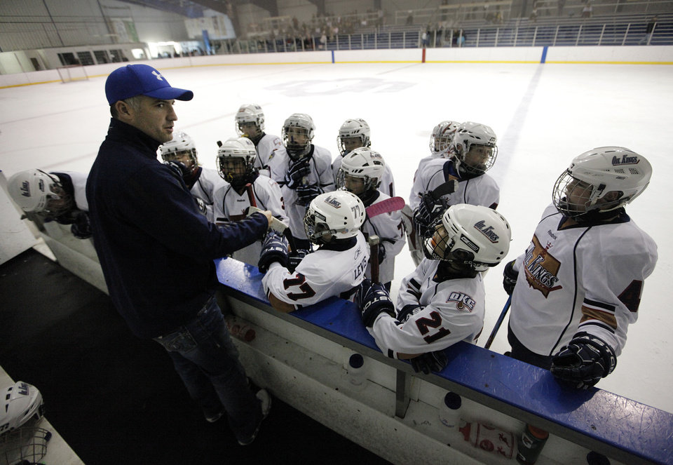 Coach Peter Robertson talks to his players in a game between the Oklahoma City Oil Kings and the New Mexico Warriors during the Oktoberfest 2012 youth hockey tournament at Arctic Edge Arena in Oklahoma City.  Photo by Garett Fisbeck, The Oklahoman <strong>Garett Fisbeck</strong>