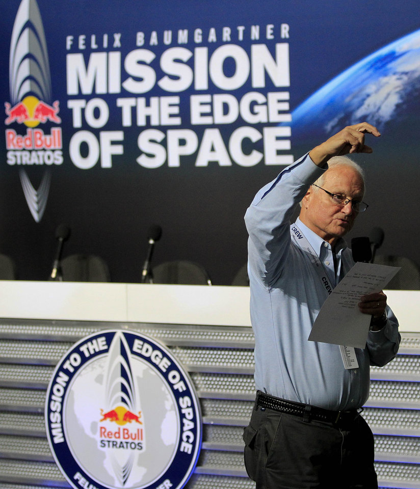 Mission Control broadcaster Robert Hager, talks about the latest weather conditions, ahead of an attempt by Felix Baumgartner to break the speed of sound with his own body by jumping from a space capsule lifted by a helium balloon, Sunday, Oct. 14, 2012, in Roswell, N.M. Baumgartner plans to jump from an altitude of 120,000 feet, an altitude chosen to enable him to achieve Mach 1 in free fall, which would deliver scientific data to the aerospace community about human survival from high altitudes.(AP Photo/Ross D. Franklin)