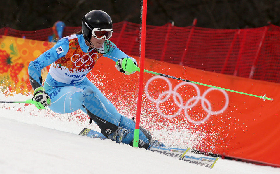 Photo - Slovenia's Tina Maze skis past a gate in the first run of the women's slalom at the Sochi 2014 Winter Olympics, Friday, Feb. 21, 2014, in Krasnaya Polyana, Russia. (AP Photo/Luca Bruno)