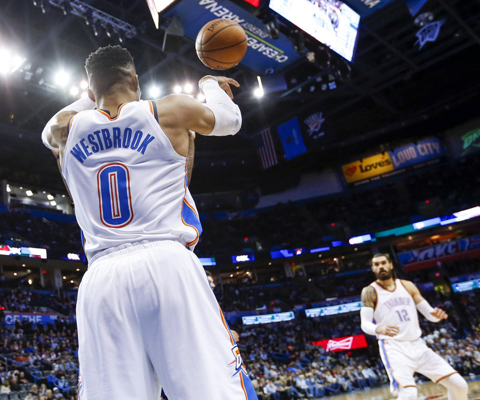 Photo - Oklahoma City's Russell Westbrook (0) inbounds the ball during an NBA basketball game between the Oklahoma City Thunder and the Orlando Magic at Chesapeake Energy Arena in Oklahoma City, Monday, Feb. 26, 2018. Oklahoma City won 112-105. Photo by Nate Billings, The Oklahoman