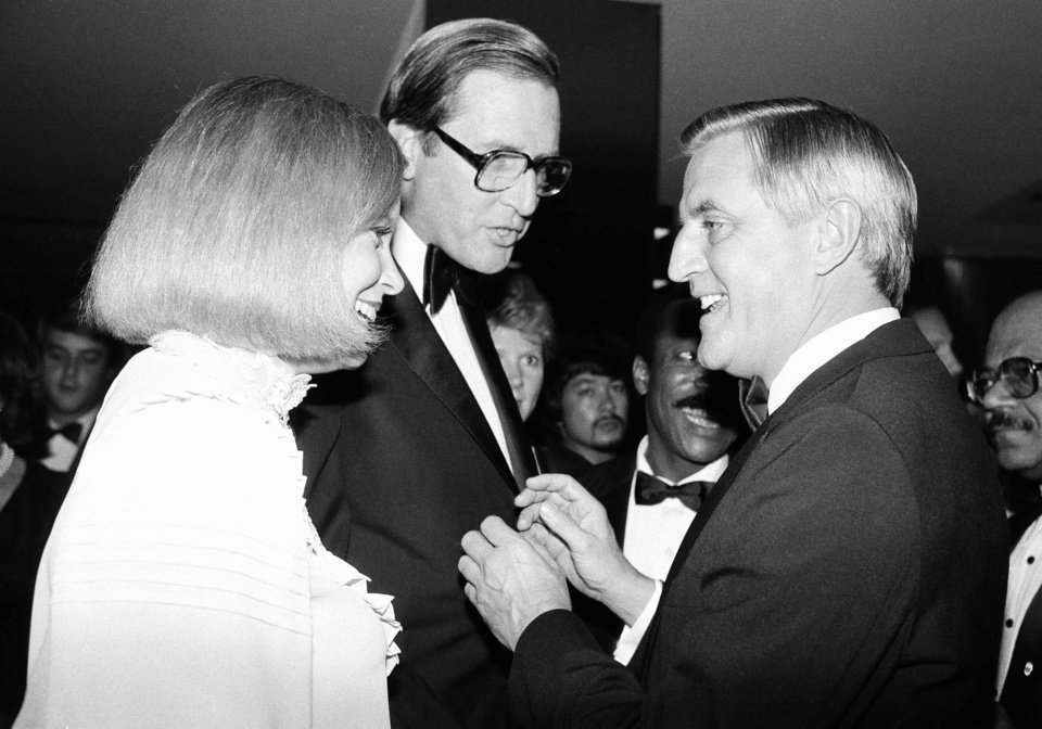 File- In this Wednesday, Sept. 28, 1983 file photo, Democratic presidential hopeful Walter Mondale, right, chats with Gov. Jay Rockefeller of West Virginia and his wife, Sharon, just before a