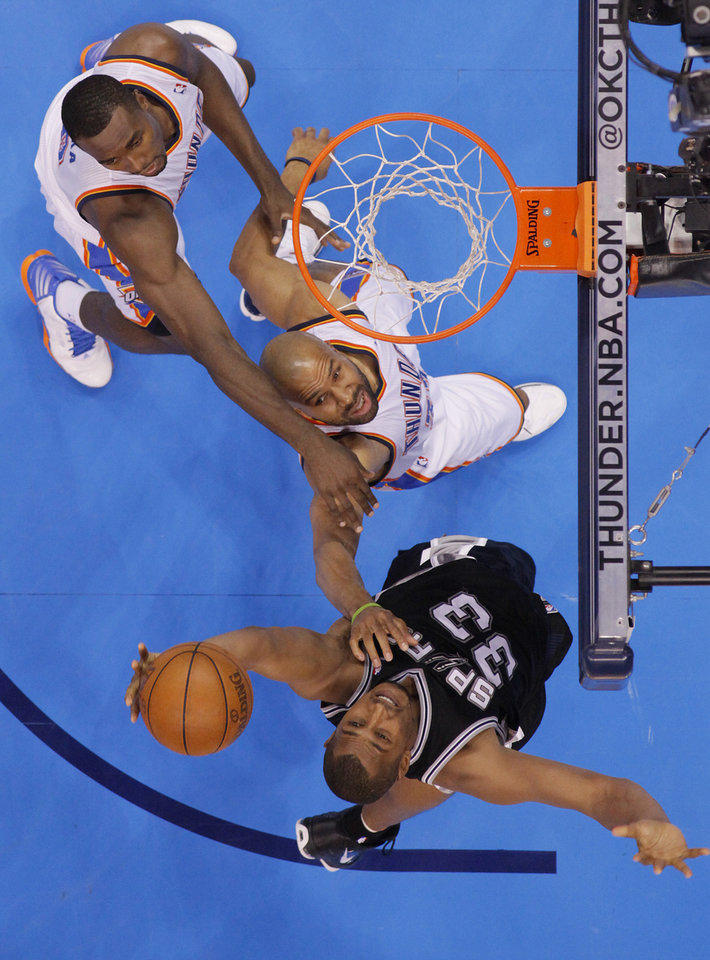 San Antonio's Boris Diaw (33) pulls in a rebound over Oklahoma City's Derek Fisher (37) and Serge Ibaka (9) during Game 6 of the Western Conference Finals between the Oklahoma City Thunder and the San Antonio Spurs in the NBA playoffs at the Chesapeake Energy Arena in Oklahoma City, Wednesday, June 6, 2012. Photo by Chris Landsberger, The Oklahoman
