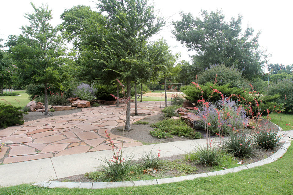 Photo - A new Oklahoma City program will help neighborhoods pay to water landscaping at city parks and medians. Photos by Paul Hellstern, The Oklahoman