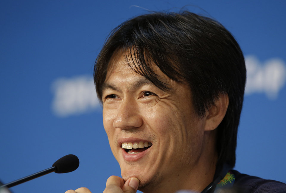 Photo - South Korea national soccer team coach Hong Myung-bo smiles while he answers reporter's question during a press conference the day before the group H World Cup soccer match between Russia and South Korea at the Arena Pantanal in Cuiaba, Brazil, Monday, June 16, 2014. (AP Photo/Lee Jin-man)