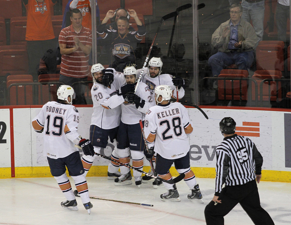 Oklahoma City Barons players celebrate after a goal during Game 2 of the Western Conference Finals against Toronto on Friday. Photo by Garett Fisbeck, For The Oklahoman