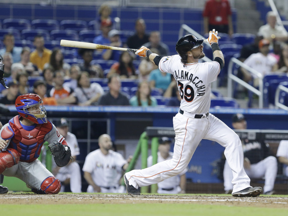 Photo - Miami Marlins' Jarrod Saltalamacchia watches the ball after he hit a home run scoring Marcell Ozuna during the eighth inning of a baseball game against the Philadelphia Phillies, Wednesday, July 2, 2014 in Miami. The Marlins defeated the Phillies 5-0. (AP Photo/Wilfredo Lee)
