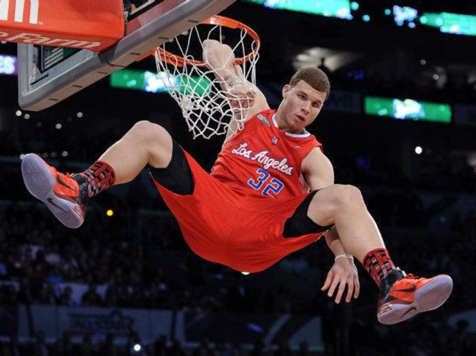 Photo - L.A. CLIPPERS: Los Angeles Clippers' Blake Griffin dunks during the Slam Dunk Contest at the NBA basketball All-Star weekend Saturday, Feb. 19, 2011, in Los Angeles.  (AP Photo/Mark J. Terrill) ORG XMIT: LAS142