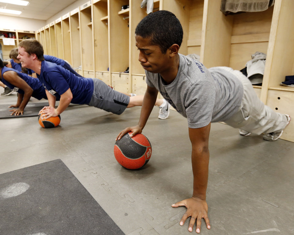 Photo - Deion Smith, Enid High School Plainsman football player, does strength and conditioning drills on Wednesday, Dec. 18, 2013 in Enid, Okla.  Photo by Steve Sisney, The Oklahoman